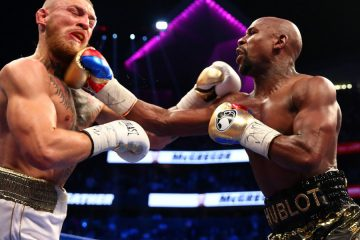 Aug 26, 2017; Las Vegas, NV, USA; Floyd Mayweather Jr. lands a hit against Conor McGregor during a boxing match at T-Mobile Arena. Mandatory Credit: Mark J. Rebilas-USA TODAY Sports